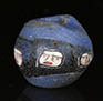 Roman mosaic glass blue bead with five ancient faces