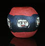 Ancient Roman face bead with 5 ancient faces on red glass matrix