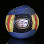 Ancient Roman mosaic glass face bead with 3 ancient faces on blue glass matrix