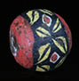 Ancient Roman glass bead with four petals pattern